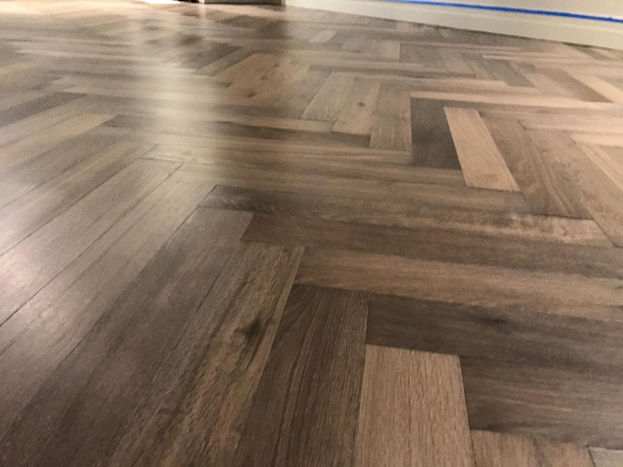 Herringbone french oak hardwood floor installation in for Wood floor herringbone