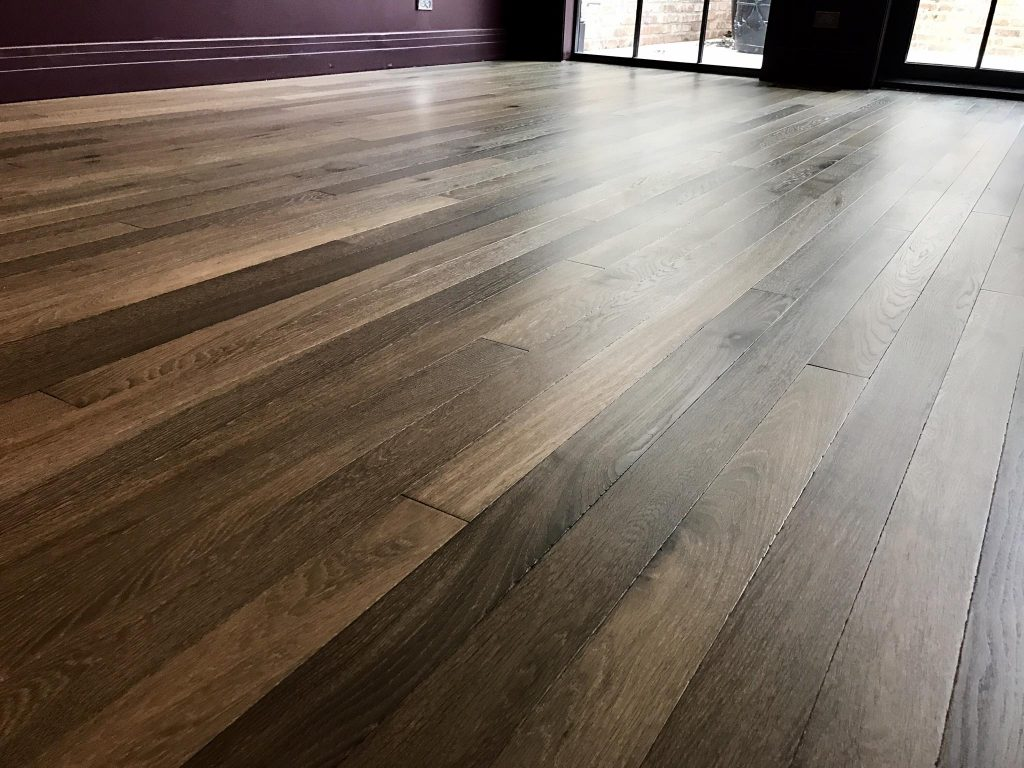 Herringbone french oak hardwood floor installation in Wood floor installer
